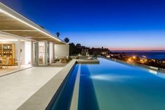 Topaz is a luxury self-catering holiday villa in Clifton with 3 bedrooms. View pictures, get rates and check availability. Sliding Glass Door, Sliding Doors, Pent House, Cape Town, Swimming Pools, Topaz, Camping, Luxury, Villas