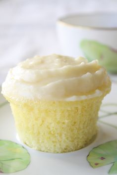 Cloud-like Lemon Cupcakes. The cake recipe looks too complicated for my lazy-cook self, but I will use the yummy frosting recipe with store-bought lemon cake mix.