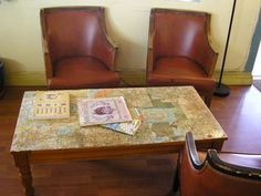 Probably wouldn't do it exactly like this but i LOVE the idea of doing map decoupage on a coffee table!!