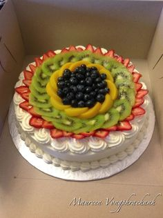 Chinese fruitcake. Sponge cake with homemade lactose free whipped cream. Strawberries, kiwi, peach in between layer