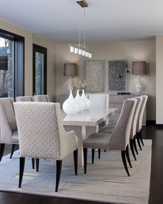 A gorgeous taupe transitional dining room with comfortable seating for 8   Orchard Lake Residence contemporary dining room