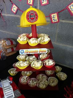 Fireman Sam Party popcorn balls in cupcake wraps. I like the addition of the hat on top.