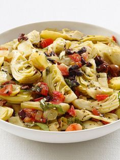 Artichokes Provencal : Transform frozen artichoke hearts into a simple Mediterranean-inspired side with white wine, tomatoes, lemon zest and some salty olives.
