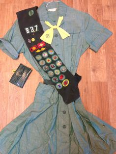 My original 1960's Girl Scout Uniform.  Still have all the pins, other badges and my Junior book. What a great organization!