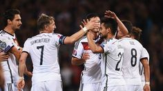 İlkay Gündoğan (2nd R) of Germany celebrates with team-mates after scoring their third goal during their UEFA EURO 2016 qualifier against Scotland