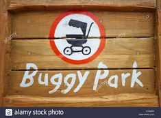 Download this stock image: Buggy Park sign on a wooden background Chessington World of Adventures Surrey UK - D7ANPH from Alamy's library of millions of high resolution stock photos, illustrations and vectors.