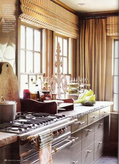 So much to talk about.... Love the chiseled countertops and stainless backsplash!