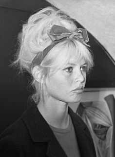 Brigitte Bardot's hair style idea. Bow headband with loose, tousled, curly updo.