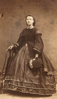 1860's - I think I can see a little veil on the hat.