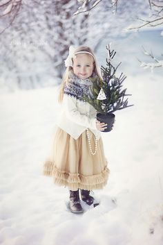 Oh, to be young again, to be proudly holding a tiny Christmas tree...without falling on the Wintered ground...