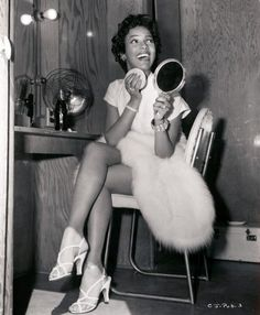 "One of my favorite Dorothy pics. Did you know that she and Nat ""King"" Cole pitched ideas to networks about doing a television sitcom together? They had a few angles, including one where they played a ""small-time pair of married performers"" who went through all kinds of ('50s sitcom-ish) scenarios as they climbed the ladder to success. They were turned down all over town. Quelle surprise!"