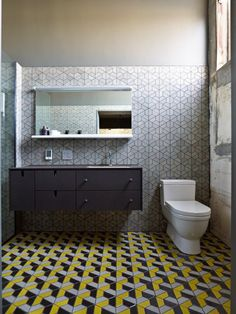 12 Rooms with Creative Tile Floors Photo. This bathroom, designed by Christina Zamora, features Half Hex Mix tiles from Heath Ceramics, which are part of their Dwell Patterns tiles. - love these wall tiles and the shelf under the mirror. Inspiration Design, Bathroom Inspiration, Design Ideas, Floor Design, Tile Design, Bathroom Floor Tiles, Tile Floor, Ikea Bathroom, Bathroom Bath
