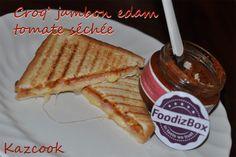un croq' tomate ? ^^  http://kazcook.com/blog/archives/481-Croq-jambon-edam-au-delice-de-tomates-sechees.html