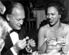 """Dorothy Dandridge and actor Curd Jürgens (her co-star in 1958's Tamango) enjoy hors d'oeuvres at aparty thrown by producer Mike Todd (then-husband of Elizabeth Taylor)for his film """"Around the World in Eighty Days"""" during the Cannes Film Festival in May 1957. Photo by Red Grandy, who has a great story about crashing the party to take this and other pictures."""