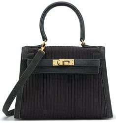 """A BLACK PLEATED SILK & LEATHER MINI KELLY 20 BAGHERMÈS, 1990Gold Hardware, interior is black leather with one slip pocket. Includes shoulder strap and dustbag. 8"""" W x 5½"""" H x 4"""" DBlindstamp T Circle"""
