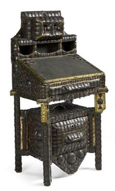 CARLO BUGATTI (attribution) WRITING DESK the wooden frame covered with coconut shell mosaic, brass repoussé, 60cm wide, 111cm high, 45cm deep | SOLD for £960 April 8, 2008