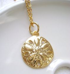 Hey, I found this really awesome Etsy listing at http://www.etsy.com/listing/76716463/gold-dollar-sand-charm-necklace