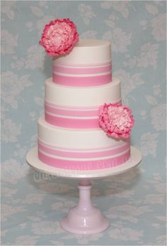 Modern wedding cake with ombre pink fondant stripes and pink bicoloured peonies.