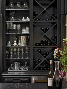 DIY Network shares these beautiful X shelf inserts (that you can buy or make at home based on the size of your shelves) that create a beautiful way to store and display your wine. by becky