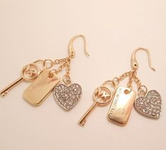 mk key earrings gold by annasheng on Etsy, $6.99  https://www.etsy.com/listing/196303903/mk-key-earrings-gold?ref=sr_gallery_6&ga_order=date_desc&ga_view_type=gallery&ga_ref=fp_recent_more&ga_page=76&ga_search_type=all