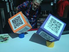 Cool idea for sharing student projects adding QR codes to these cubes. They displayed the cubes for parents to scan during family night.