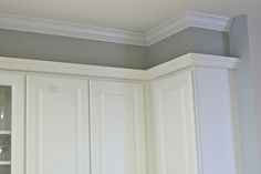 Fixing that gap between the cabinets and the ceiling.