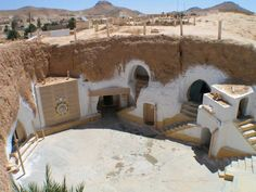 """The traditional underground homes are sometimes described as """"troglodyte"""" structures. They are found in Matmata, Tunisia. Underground Living, Underground Homes, Underground Building, Eco Buildings, Amazing Buildings, Office Buildings, Green Building, Building A House, Urban Ideas"""