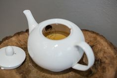 Teapot with inner detail basking women is a great design and functional accessory.