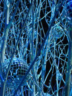 Winter wedding room decor. White birch branches with mini disco balls