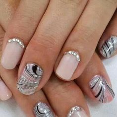 Nude nails with sparkle and stripes