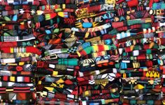 """""""wall of blankets"""" around 100 colourful old blankets"""