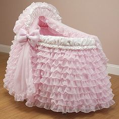 #American Welcome your new addition with this bassinet set. This #pink bassinet set has an extra-ruffly skirt accented with pink bows for a girly touch and featu...