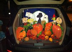 It's the Great Pumpkin Charlie Brown Trunk or Treat 2014... DIY entirely from recycled card board, acrylic paint and assorted leaves and pumpkin accessories. What fun watching kids faces light up and a much needed playful and wholesome influence on a night when things can be overly scary and dark for little ones. We set out to provide kiddies with smiles and fun and we succeeded in bringing the light.