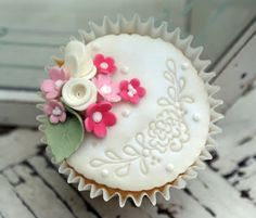Little flower cluster cupcake with fondant embossed design