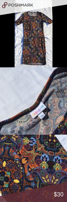 """Lularoe Julia Lularoe form fitting midi dress in a women's medium. Contains a catching blue, purple, yellow, orange black and green paisley/ikat design. Worn only once. Made out of 96% polyester 4% spandex.   All measurements are approx and taken during flat lay:  Armpit to armpit 17"""" Collar to hem 37"""" LuLaRoe Dresses Midi"""