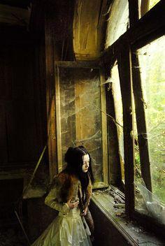 ...in her alter.altar house......slightly dilapidated in myriad ways