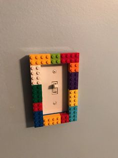 Lego Bedroom This is a great light switch, with 2 layers so kids can switch the positions of the LEGO. is the perfect Lego room storage idea for keeping your boys Lego room tidy and organized. Boys Lego Bedroom, Lego Bedroom Decor, Boy Room, Boy Bedrooms, Minecraft Bedroom, Deco Lego, Lego Bathroom, Lego Decorations, Lego Wall