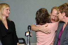 Walt hugging Heidi Napier as wife Cindy and Shannon Beretta watch.