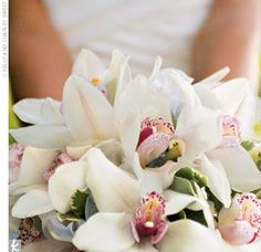 The bride and bridesmaids carried white and raspberry cymbidium orchids, while orchids also graced the head table at the reception.