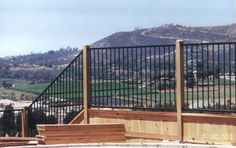 iron and wood fence - Google Search