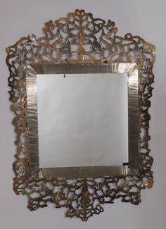 Lace mirror, sheet metal, powder coated.