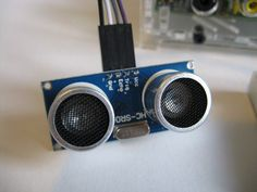 Ultrasonic transducer modules are an easy way to add distance measuring capability to your Pi. The device shown in the photo has 2 power pins, 1 trigger pin and 1 echo pin.