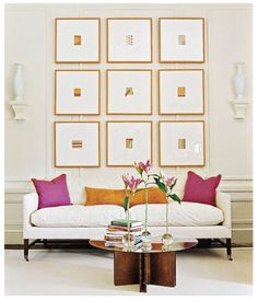 Gretchen says: Look past the art and you will notice it was hung symmetrical on the paneling as well. I love the mats, they raise up the chic factor.