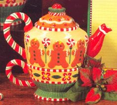 This highly decorated Tea for One is microwave and dishwasher safe. It would make any table a special occasion. It has a candy cane like handles with red, green, and white colors. The spout is red wit