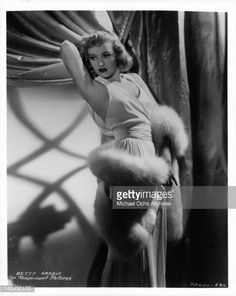News Photo : Betty Grable in an evening gown and a white fur...
