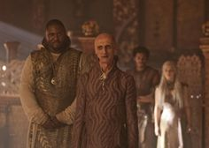 Still of Nicholas Blane, Ian Hanmore and Emilia Clarke in Game of Thrones