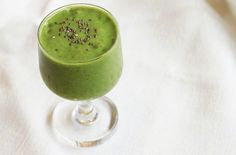 Green Smoothie |  This particular smoothie is made by blending two frozen bananas, fresh kale, fresh avocado, almond milk, ice, dates, almond butter, hemp seeds, chia seeds and spirulina (optional) together until smooth.   The finished product is a thick emerald-hued drink that will get you pumped to start your day.