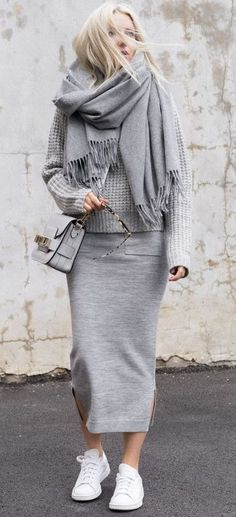 all grey. street style. everyday outfit. knit. midi skirt. trainers.