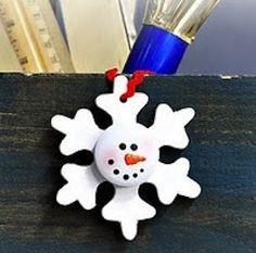 Check out this adorable Wooden Snowman Snowflake! How cute would this look up on your tree this year?
