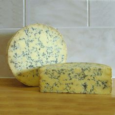 Dorset Blue Cheese PGI - Dorset Blue is a lightly pressed cheese with a firm texture. It has a uniform colour with irregular blue/green veining and a rough dry brown mould coating. The cheese is piquant, peppery, with a mild to strong flavour.  Production of the cheese is limited to the County of Dorset.